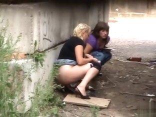 Two Ukrainian girls caught peeing outdoors
