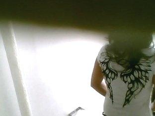 Dark haired dark skinned girl in a domestic pissing porno vid