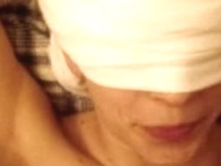 Blindfolded girlfriend receiving a facial cumshot on her chin