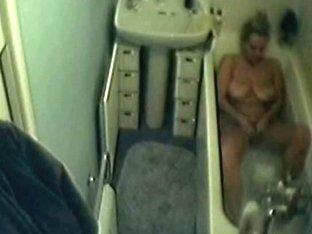 Curvy blonde wife bathing