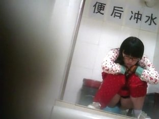 Geeky chinese girl spied while pissing