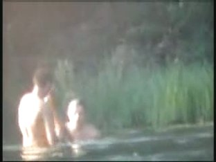 Three hot people having sex in the water