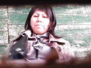Kazakhstan women caught peeing into a dirty hole