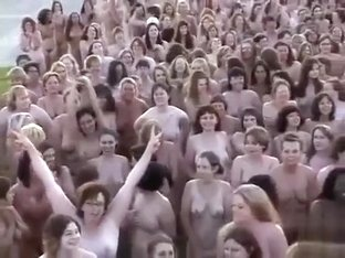 Hundreds of nudists strip for a camera man