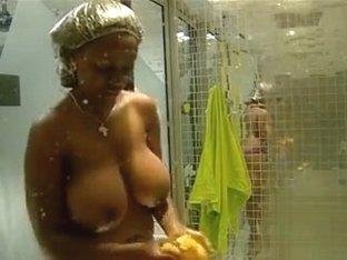 Black amateur with big breasts in voyeur shower scene