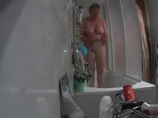 My chubby aunt gets caught on tape showering