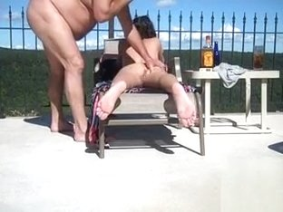 Nudist girl's pussy gets penetrated by the pool