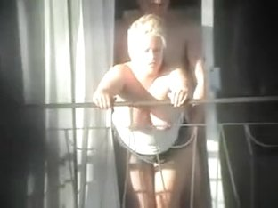 Busty cougar gets dicked on the balcony