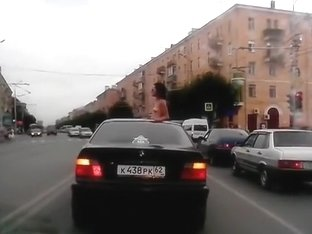 Topless babe riding in a BMW while in Russia