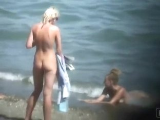 Skinny naked girl at the beach gets spied