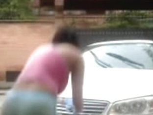 Cute little girls fooling around while washing a car