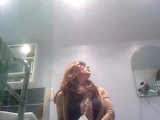 Mature woman caught on voyeur's camera pissing