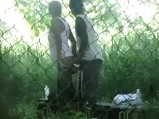 Voyeur tapes a black girl couple having sex on bench in the park