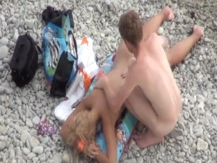 Super sexy golden-haired naked on the beach