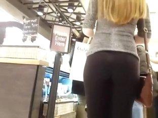 Blonde chick wearing tight black leggings