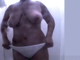 Chubby woman with big tits and hairy pussy spied