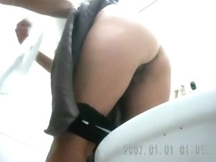 Brunette goes poop in a hidden camera video