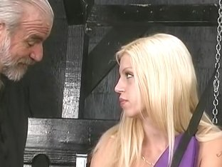 Miniature-titted blond in swing plays with her cum-hole