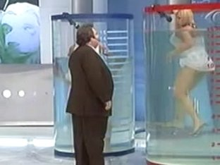 Amazing blonde flashes her meaty body in water upskirt on tv