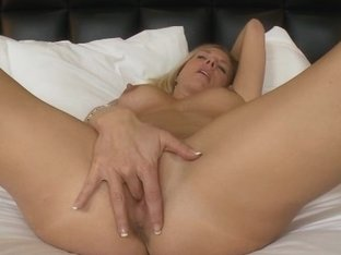 Blowjob and pussy play by a blonde MILF