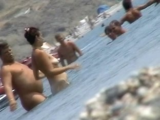 Women caught going in and out of the water with a spy cam