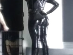 Masters and a hot slave in latex having fun