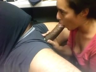 Hot babe blows a black cock in the office