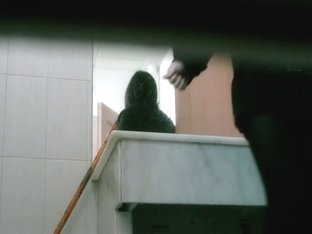 Toilet camera video shows a gorgeous Asian chick preparing to piss.