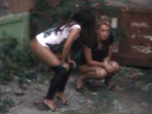 Hidden peeing cam shooting two girls pissing in the yard