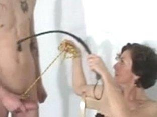 Dominant mature broad sucks off her slave