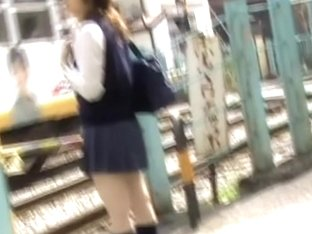 Teenage oriental hoe is waiting for the bus during street sharking action