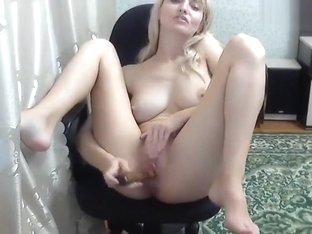 Blonde XXKISAXx fucks herself on a chair