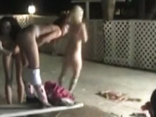 Naked girls put firecrackers up their ass outside
