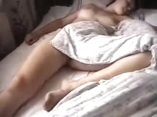 Made an non-professional homemade clip during the time that sexy mom was lying undressed on the co.