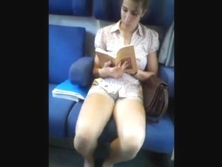 girl very nice in shorts reading in train