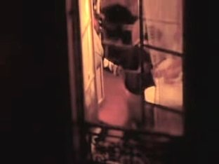 American tourist shaking her nude boobs in the hotel window
