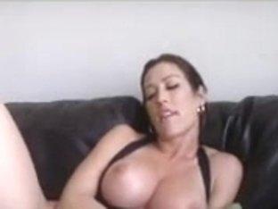 Breasty milf, Capri, finger-fucks her snatch