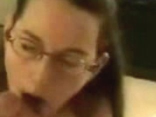 Cute chick with glasses giving amazing blowjob