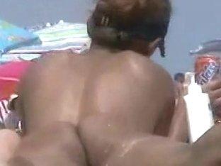 Amazing beach voyeur vid of two nudist girls and their wet pussies