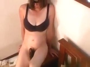 Making sexy amateur porn videos is my hobby. In this one, I'm fucking my hairy twat with a big dil.