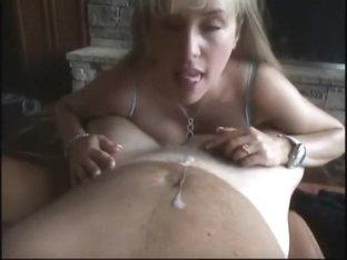 Slut with huge jugs jerking cock