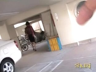 Asian babe unlocking her bike gets a skirt sharking.