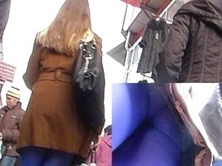 Ass in blue tights up the coat