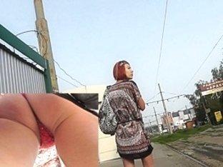 Classy redhead upskirt video