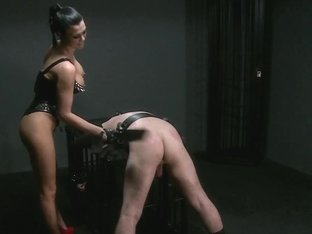 Silent hooded slave boy receives brutal treatment from gorgeous Dominant Mistress