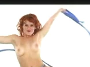 Redheaded MILF babe dancing around totally naked