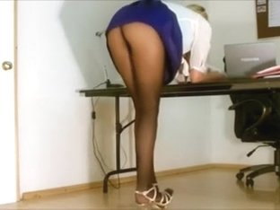 A hot office colleague in hot skirt flashing a-hole