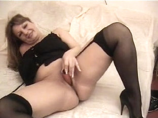 Mature large marvelous woman stuffing her wet crack