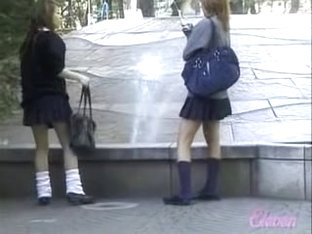 Fountain sharking action with two Asian schoolgirl being in the middle of it
