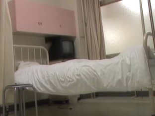 Japanese nurse was making a bed when man sharked her bottom